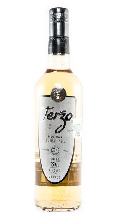 Bottle of Terzo Tequila Añejo
